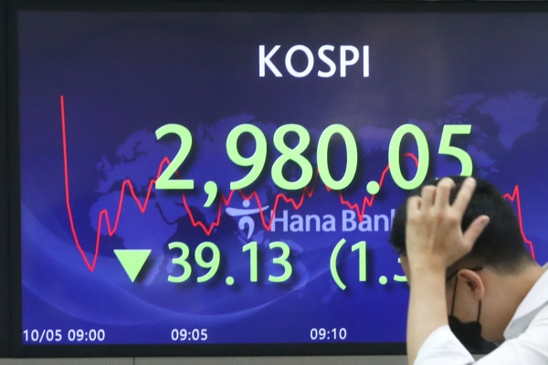 Seoul stocks open higher on stabilizing currency market