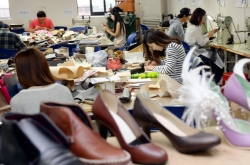 Students learn traditional shoemaking trade