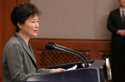 Park says will accept impeachment vote 'with heavy heart'