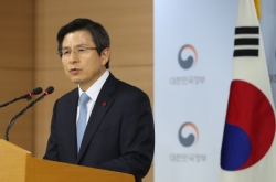 Hwang apologizes, vows no vacuum