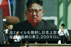 Launch shows Kim's determination to complete weapons program: experts