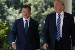 Moon greets Trump at US base