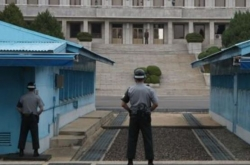 In symbolic move, NK art troupe likely to walk across tense border