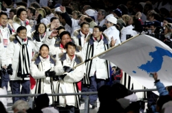If two Koreas march together at Olympics, what flag do they raise?