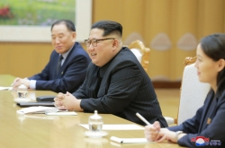 What pushed NK to form conciliatory mood?
