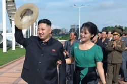 Parties show mixed reactions to N. Korea's nuke test suspension