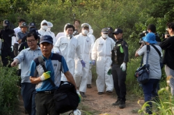 Autopsy to determine the identity of remains found on Gangjinsan