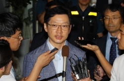 Gov. Kim heads home after overnight interrogation in opinion rigging probe