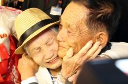Tears, hugs, joy as family reunions begin