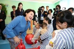 Two Koreas' first ladies visit children's hospital, music school