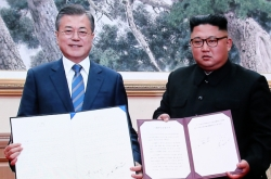 Kim vows to visit Seoul, dismantle nuke, missile sites