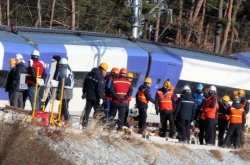 Recovery work continues on derailed KTX train site amid cold weather