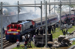 S. Koreans return home after 10-day inspection of N. Korea's eastern rail line