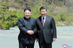 NK leader tries to maximize leverage in nuclear talks through China visit: experts