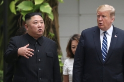 Kim, Trump seen strolling on hotel grounds