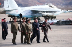 NK leader supervises test-fire of new tactical guided weapon: KCNA