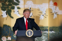 Trump says he will visit DMZ with Moon