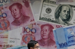 US designates China a 'currency manipulator' as trade war rages