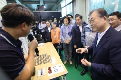 Moon visits high-tech material maker amid trade fight with Japan