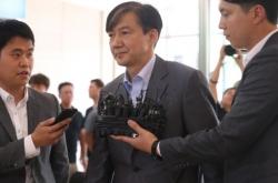 Prosecution raids key locations in probe into embattled Cho Kuk