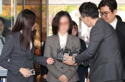 Ex-justice minister's wife appears for arrest warrant review hearing