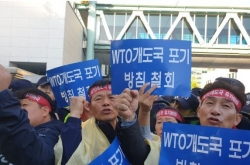 Farmers protest Seoul's decision to abandon developing country status