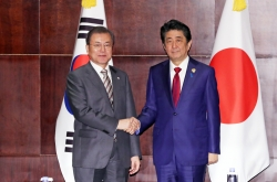 Seoul, Tokyo remain apart on forced labor issue, but stress dialogue at summit