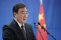 China envoy urges Seoul to follow WHO advice on virus response