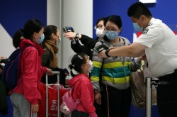 China virus death toll nears 1,500 but new cases fall