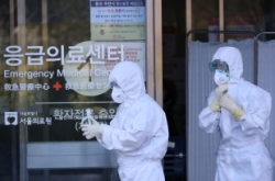 S. Korea steps up containment efforts as virus cases jump to 156