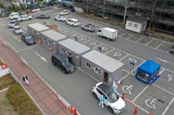 Drive-thru clinics, drones: Korea's new weapons in virus fight