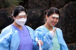 S. Korea reports 131 more cases, total at 7,513