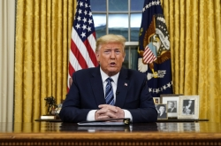 In battle against virus, Trump restricts travel from Europe