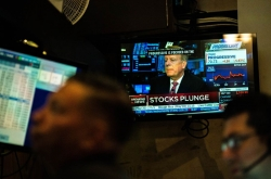 Global stocks suffer historic rout, shrugging of central bank steps