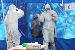 S. Korea tightens quarantine on arrivals from Europe, new virus cases dip below 100 again