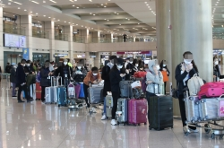 Stricter containment steps necessary for US arrivals: experts