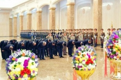 N. Korea makes no mention of visit to mausoleum by leader Kim on late founder's birthday
