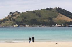 Health authorities on edge as tourist bookings to Jeju surge