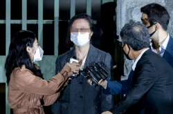 Ex-justice minister's wife released from detention