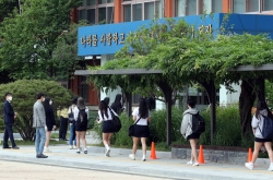 First day of school reopening goes relatively smoothly, with virus worries ever-present