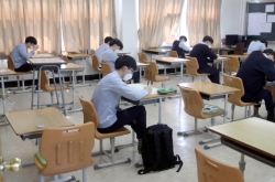 High school seniors sit exam back in classroom