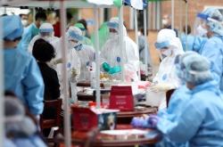 Patient surge puts fresh strain on hospitals in Gwangju