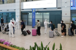 More S. Korean workers return home from virus-hit Iraq