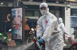 New virus cases fall back below 100 as nation vigilant ahead of key holiday
