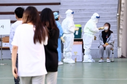 S. Korea's daily COVID-19 cases back in triple digits
