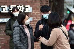 Half a million take college entrance exam as virus surges