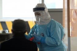 New virus cases in 400s for 2nd day amid downward trend