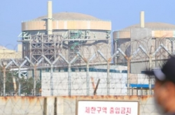Arrest warrant sought for ex-industry minister over reactor shutdown controversy