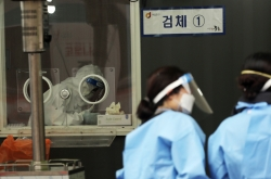 New virus cases at over 2-month low on fewer tests, infection slowdown