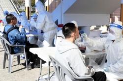 New virus cases in 400s for 2nd day, upticks worrisome amid spring break